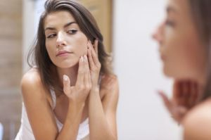 woman-looking-face-mirror.jpg.653x0_q80_crop-smart